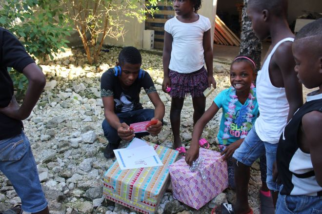 Orphans opening their Christmas gifts 2